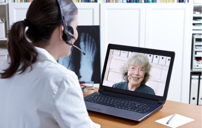 senior woman using video chat to contact her doctor