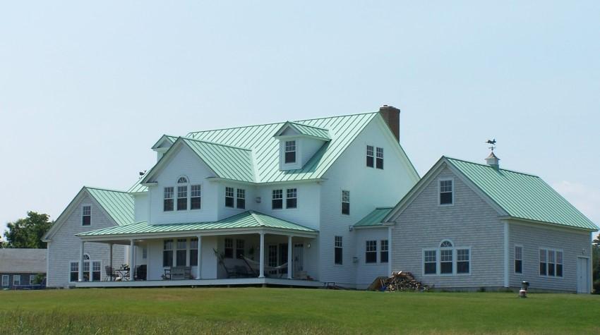 Thiết kế nhà mái tôn màu xanh ngọc 2 tầng