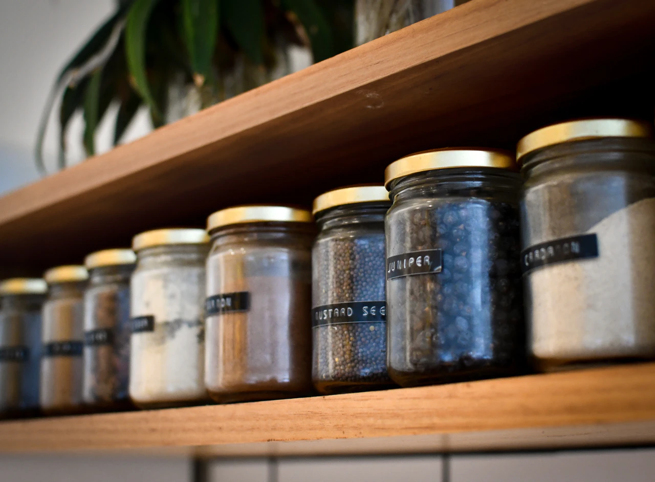 Pantry shelf with labeled spice jars
