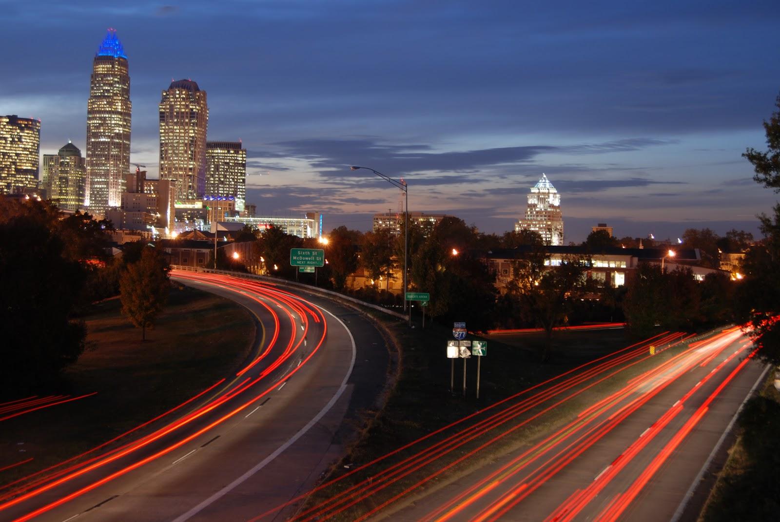 https://get.pxhere.com/photo/sunset-road-bridge-skyline-traffic-night-morning-highway-city-skyscraper-urban-cityscape-downtown-dusk-evening-twilight-landmark-charlotte-infrastructure-metropolis-north-carolina-car-trails-urban-area-human-settlement-metropolitan-area-502629.jpg