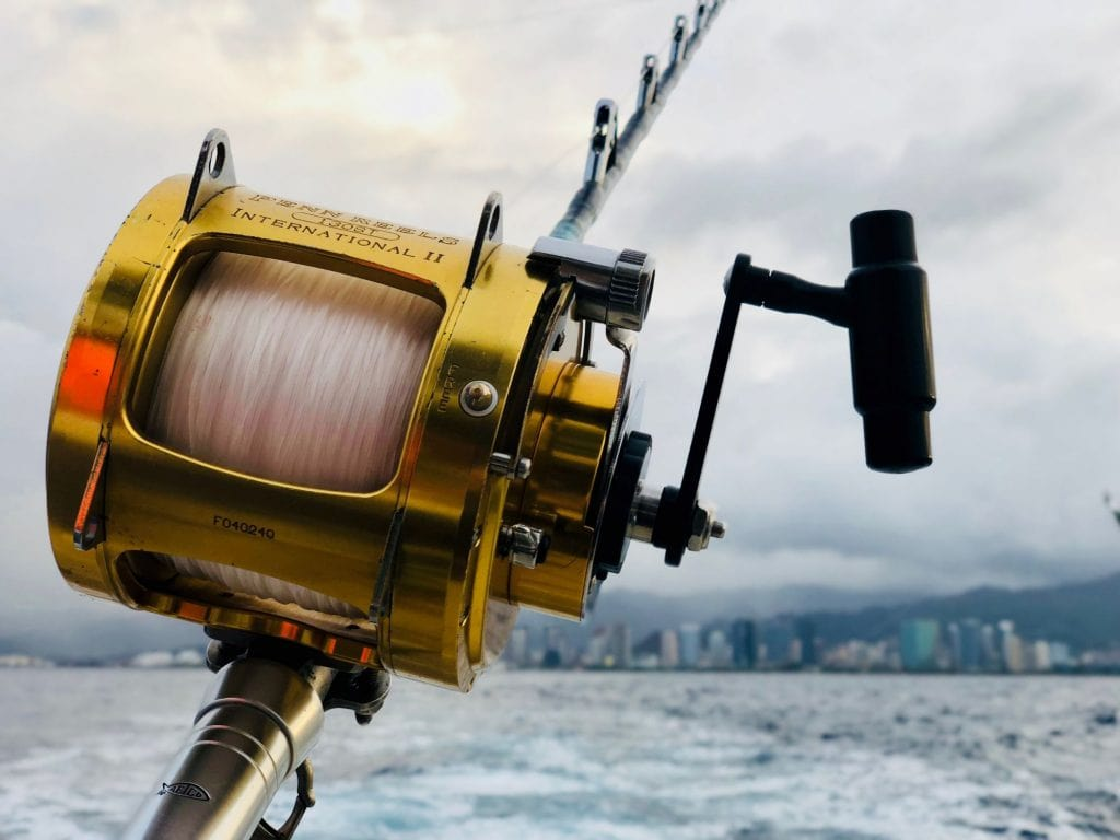 Close up Shot of a Fishing Reel with a Clear Line