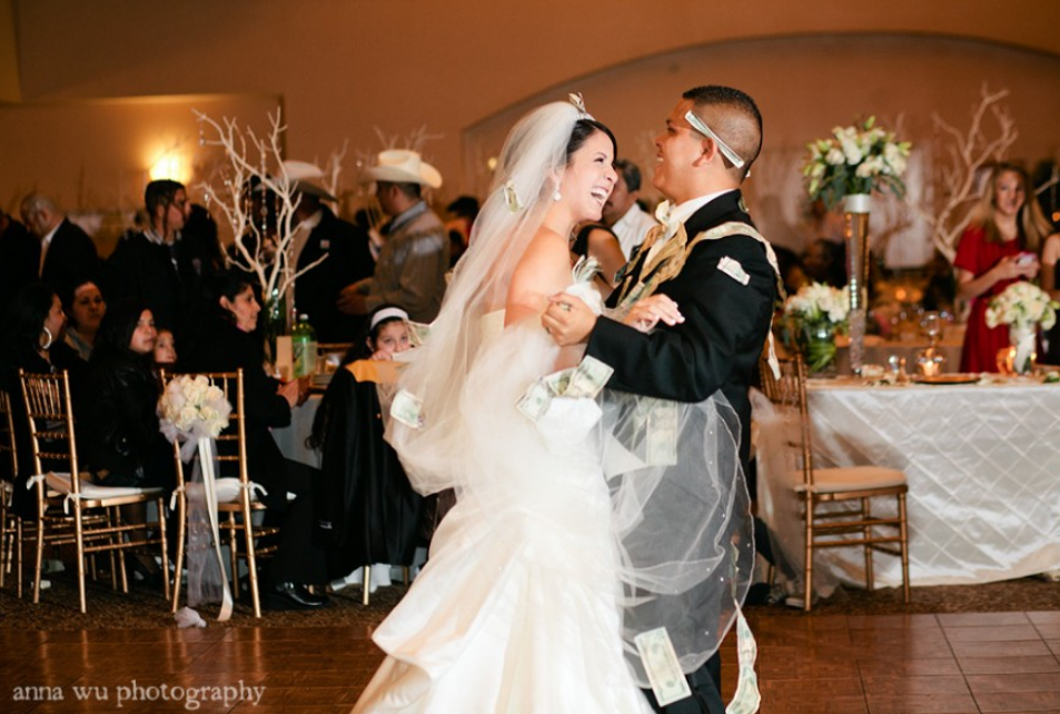 Hispanic bride and groom having their first dance.