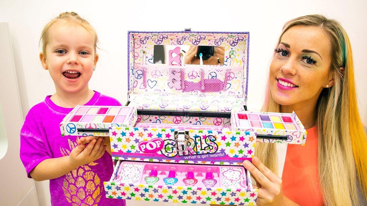 Gabriella and Mom showcasing Pop Girls makeup box.