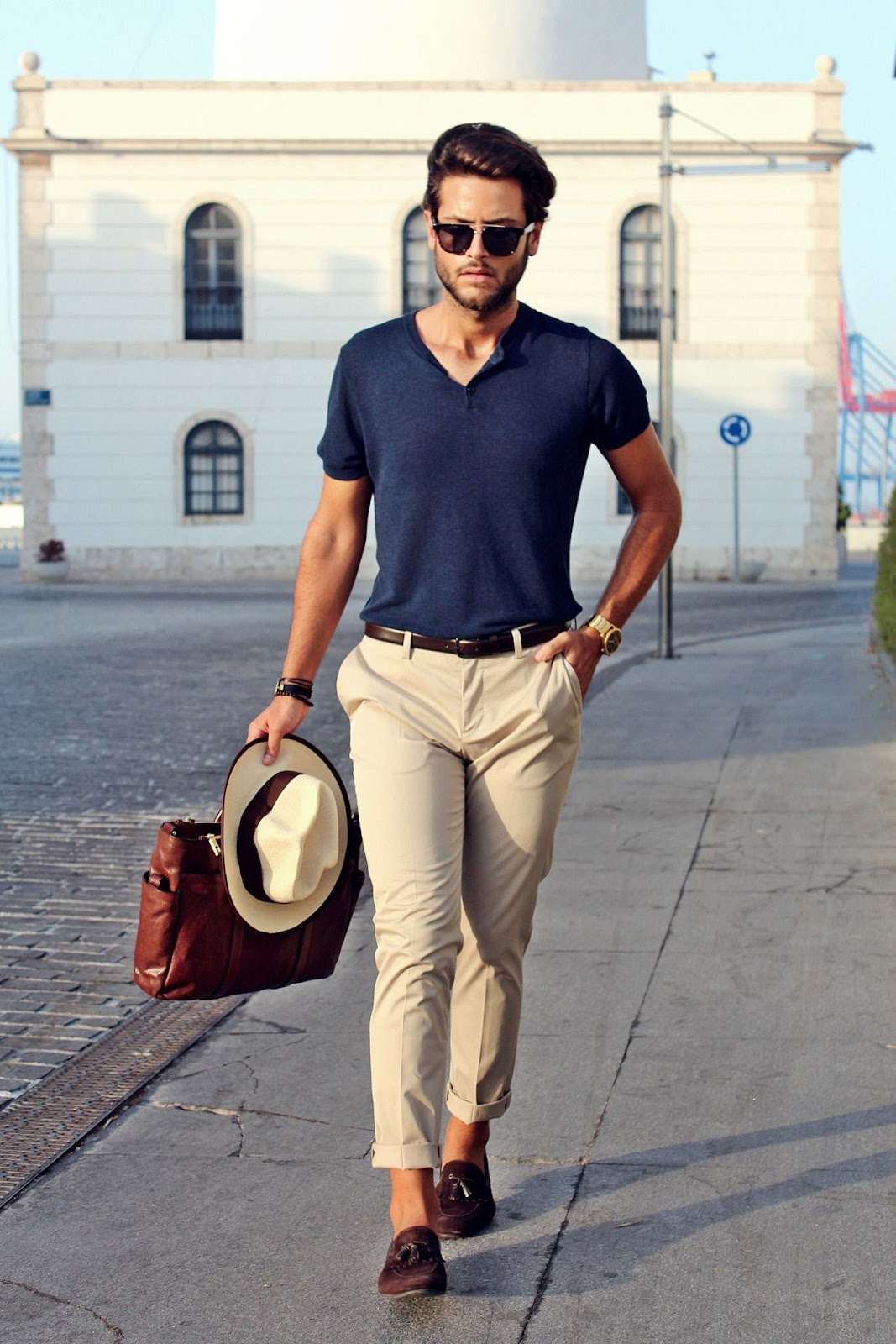 man wearing blue t shirt and fawn coloured pants