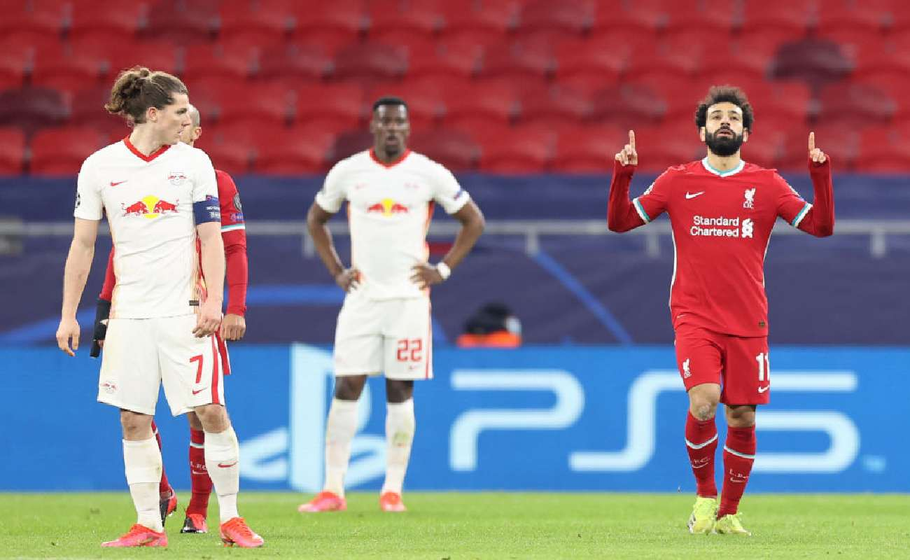 Alt: Mo Salah celebrates after scoring a goal in the UCL against RB Leipzig - Photo by David Balogh/Getty Images