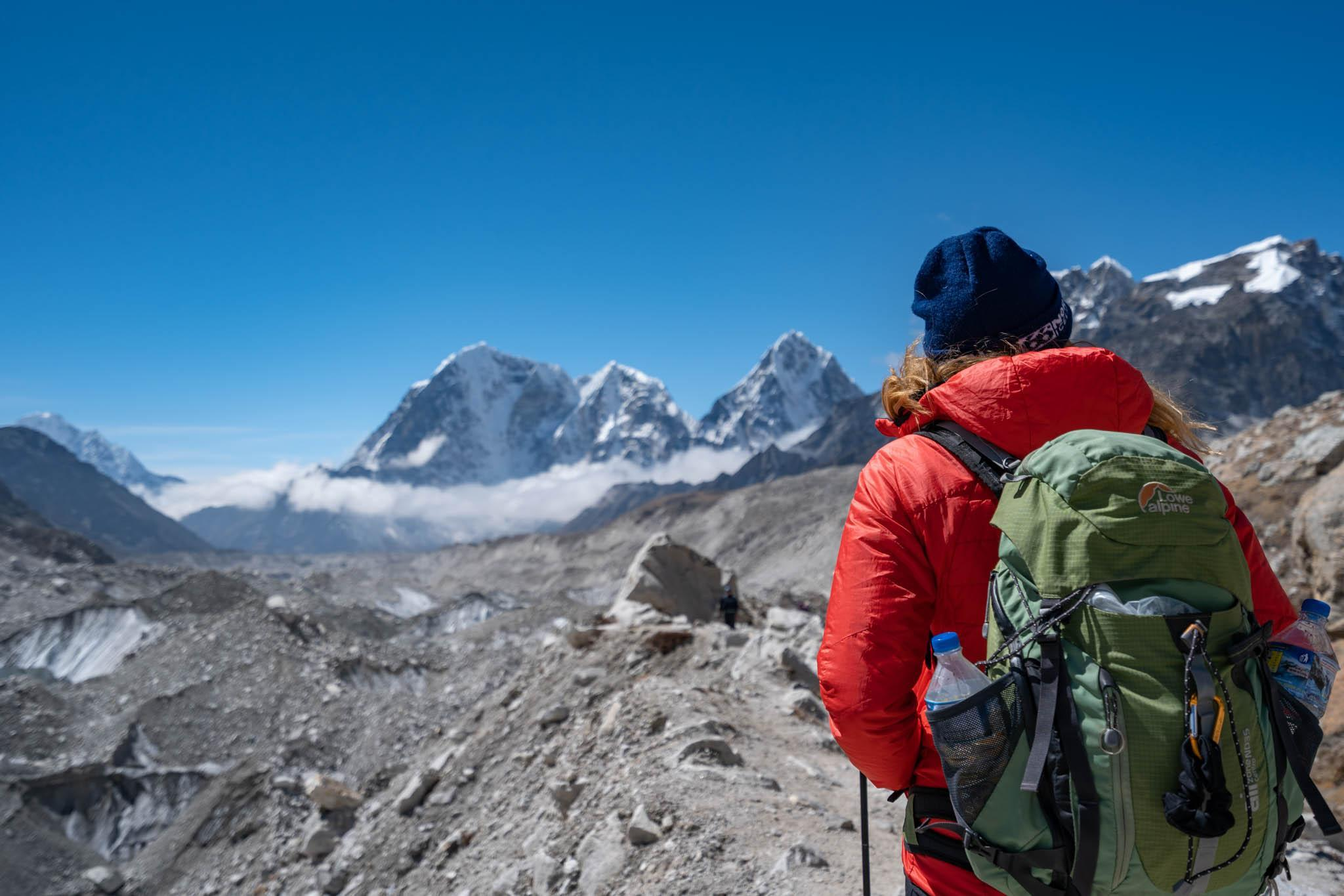 A women in a red jacket on the Everest Base Camp trek
