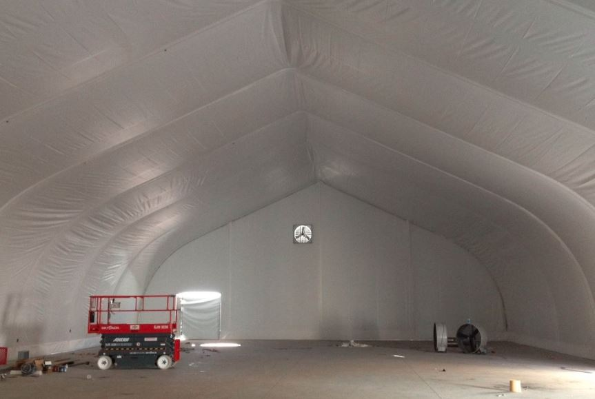 interior insulation liner covers floors and ceiling of a tension fabric structure