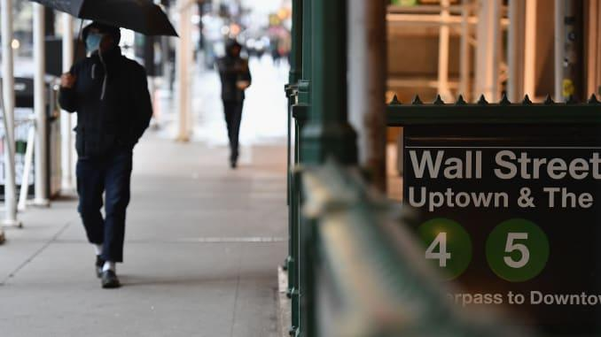 A man walks by the Wall Street subway sign on March 23, 2020 in New York City.