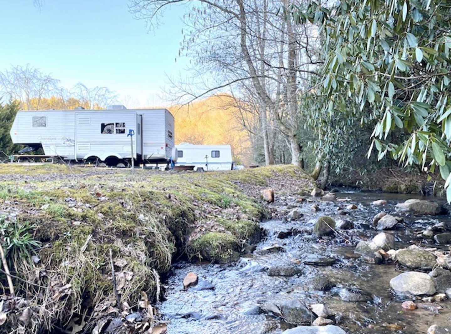 RV parked next to river at J&Js getaway campground