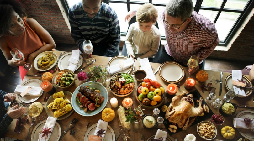 A family gathered around a Thanksgiving dinner table