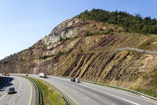 rock outcrop alongside a road
