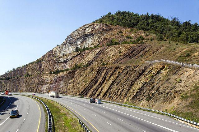 rock outcrop alongside a road