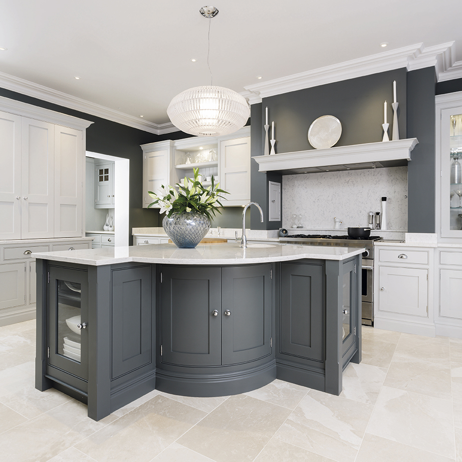 geometric l-shaped kitchen island in a grey and white kitchen design with light tile floors