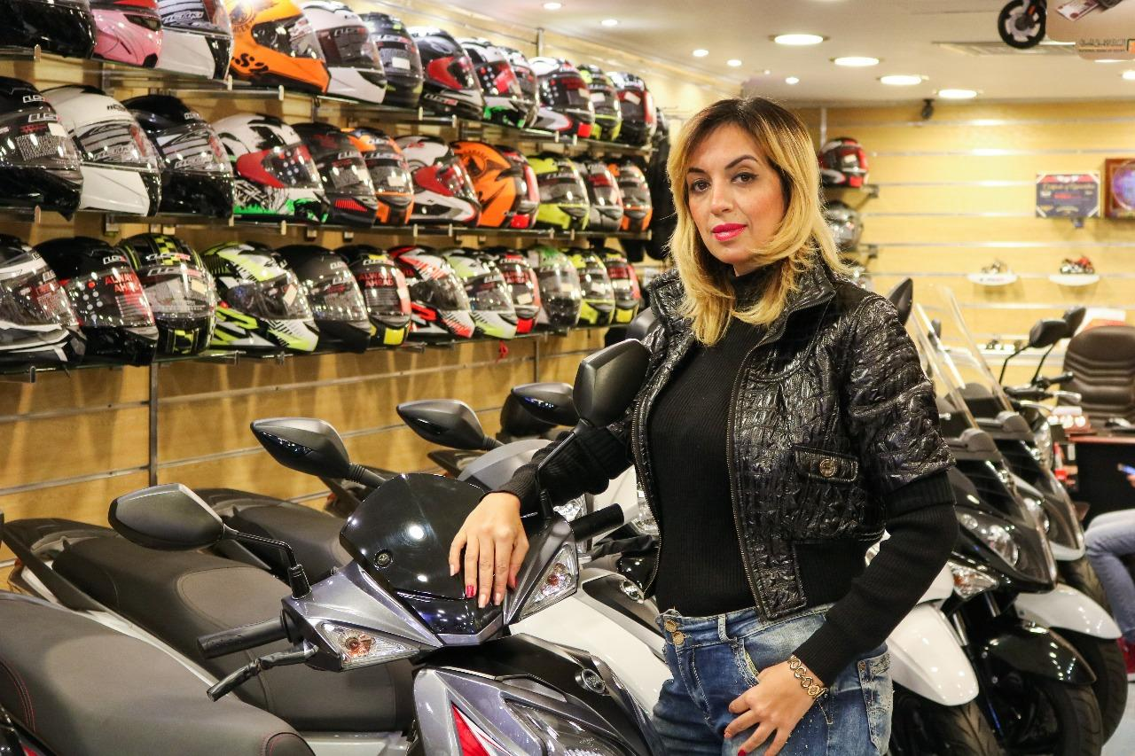 Photograph of Sally El-Gindy during a scooter exposition in Wheels Scooter House, Alexandria
