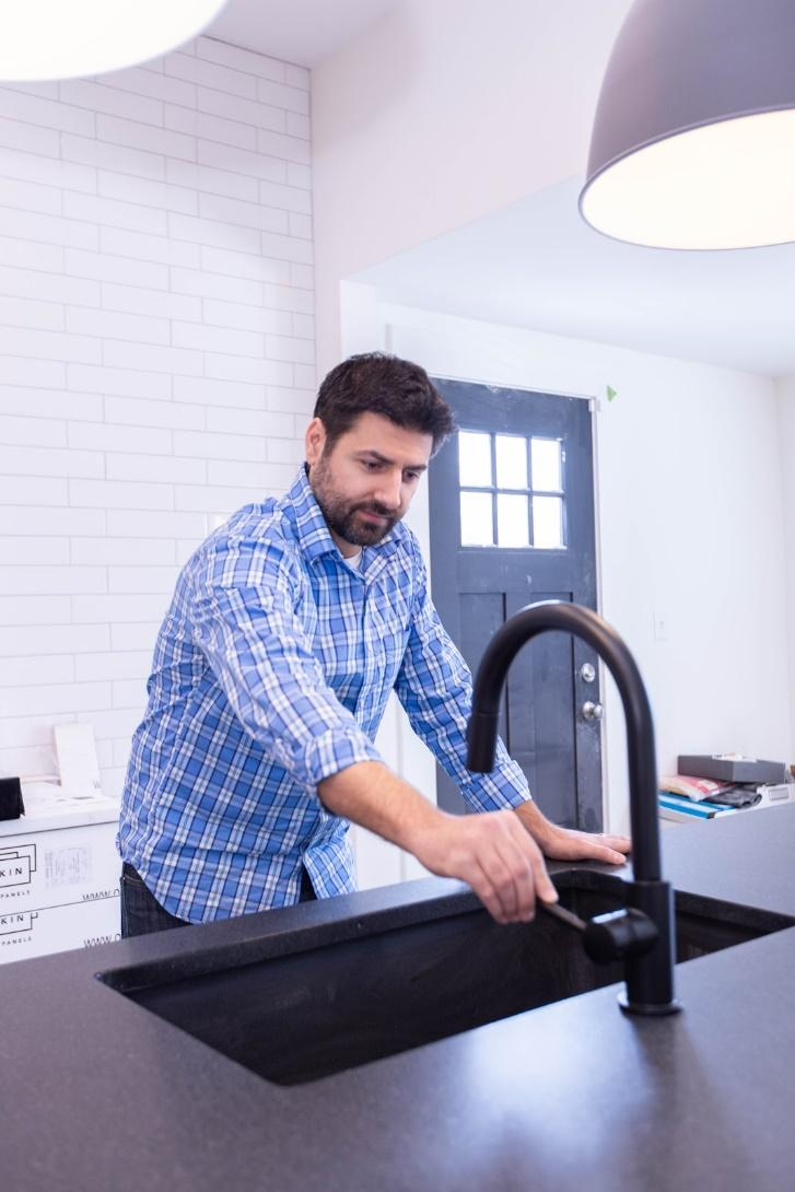 person operating the sink