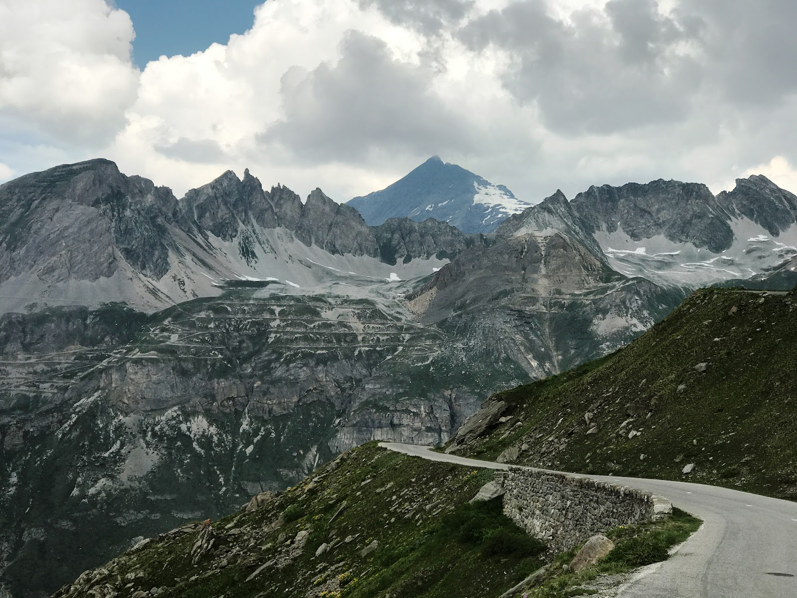 Cycling one of the best bike climbs in Europe - Col de L'Iseran from Val d'Isère - quarry, road, mountains, clouds