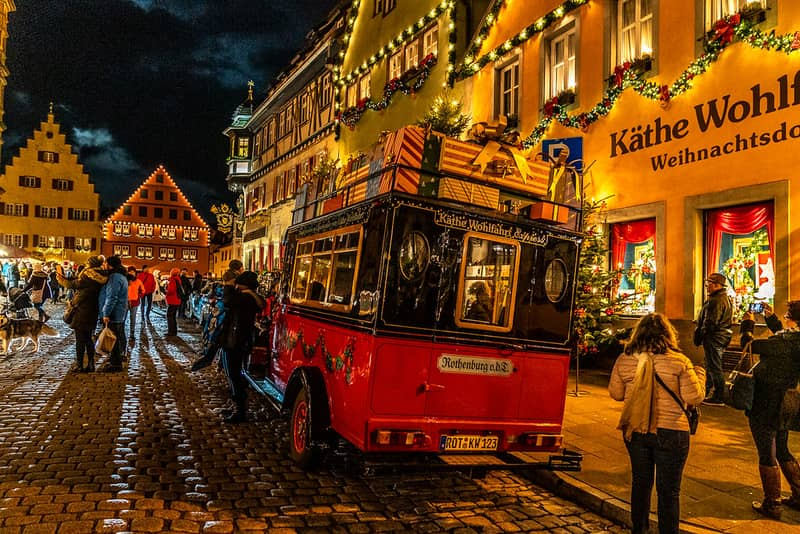 Decorative Christmas themed bus on a cobbled street in Rothenburg