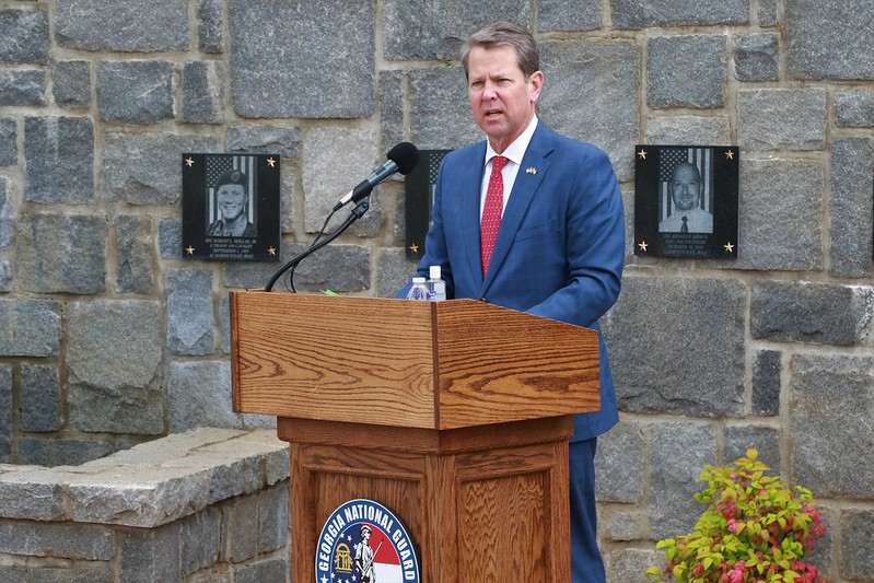 """Coca-Cola. Brian Kemp, the Governor of Georgia, speaks during a virtual Memorial Day ceremony at Clay National Guard Center in Marietta, Georgia on May 21, 2020. Kemp said he isn't afraid of """"Stacy Abrams and Joe Biden and the left"""" after Coca-Cola CEO James Quincey derided his state's election reform laws."""
