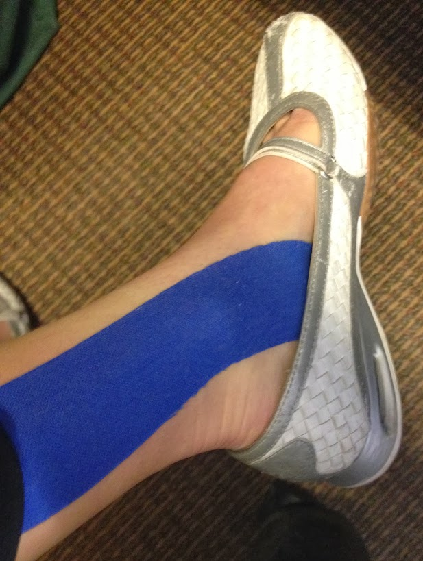 KT tape back on foot for plantar fasciitis