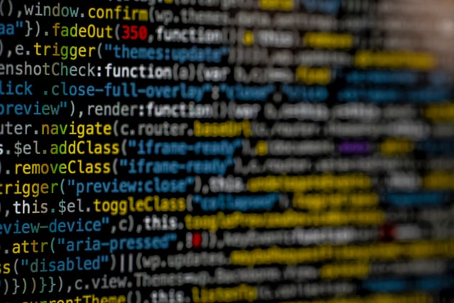 A computer screen with programming language written in blue, white, yellow and red color.