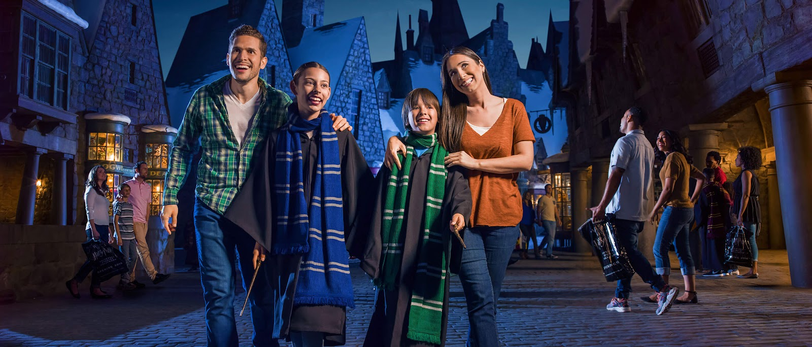 A family of four walking in the Wizarding World of Harry Potter at Universal Studios.
