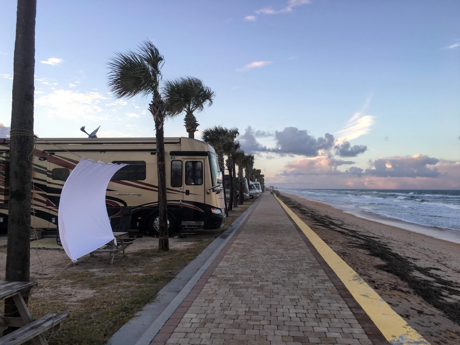 Class A RV parked at a beach-side campsite