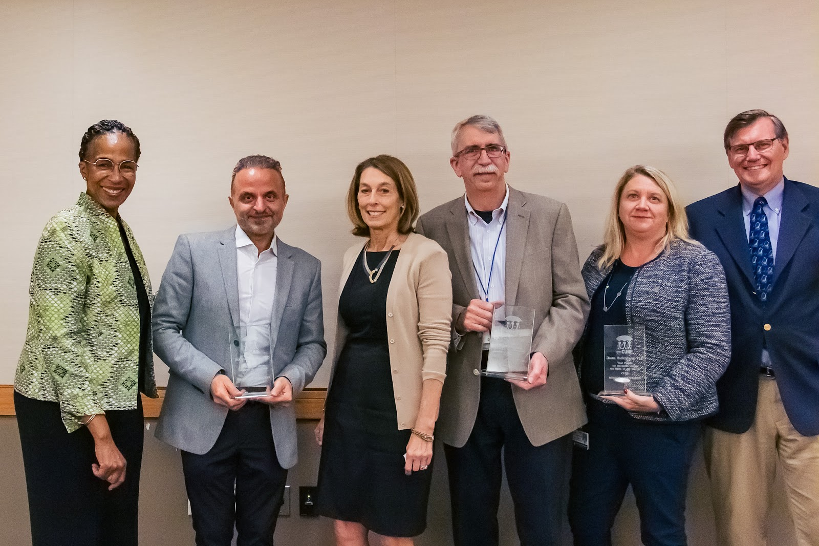 Left to Right: Karen Burns White;Bakkhos Tannous, PhD (MGH); Laurie Glimcher, MD (DFCI); David Hill, PhD (DFCI); Diane Bielenberg, PhD (BCH) and James DeCaprio, MD (DFCI). Photo by Katharin Shaw.