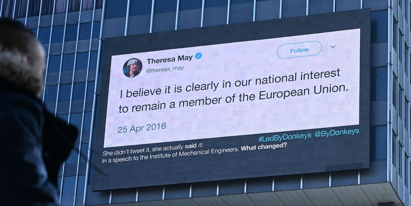 """Billboard by Led By Donkey, displayed as a tweet by Theresa May saying """"I believe it is clearly in our national interest to remain a member of the European Union."""""""