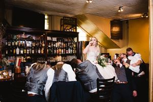 small wedding venue party with wedding party at bar