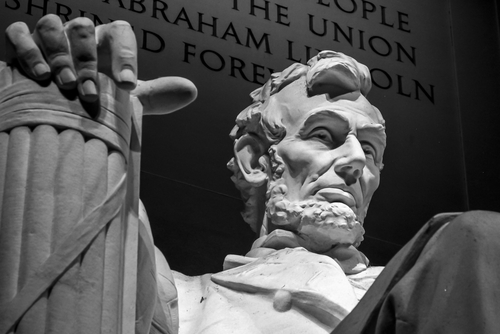 Close up of Lincoln Memorial showing Lincoln's face and hand.