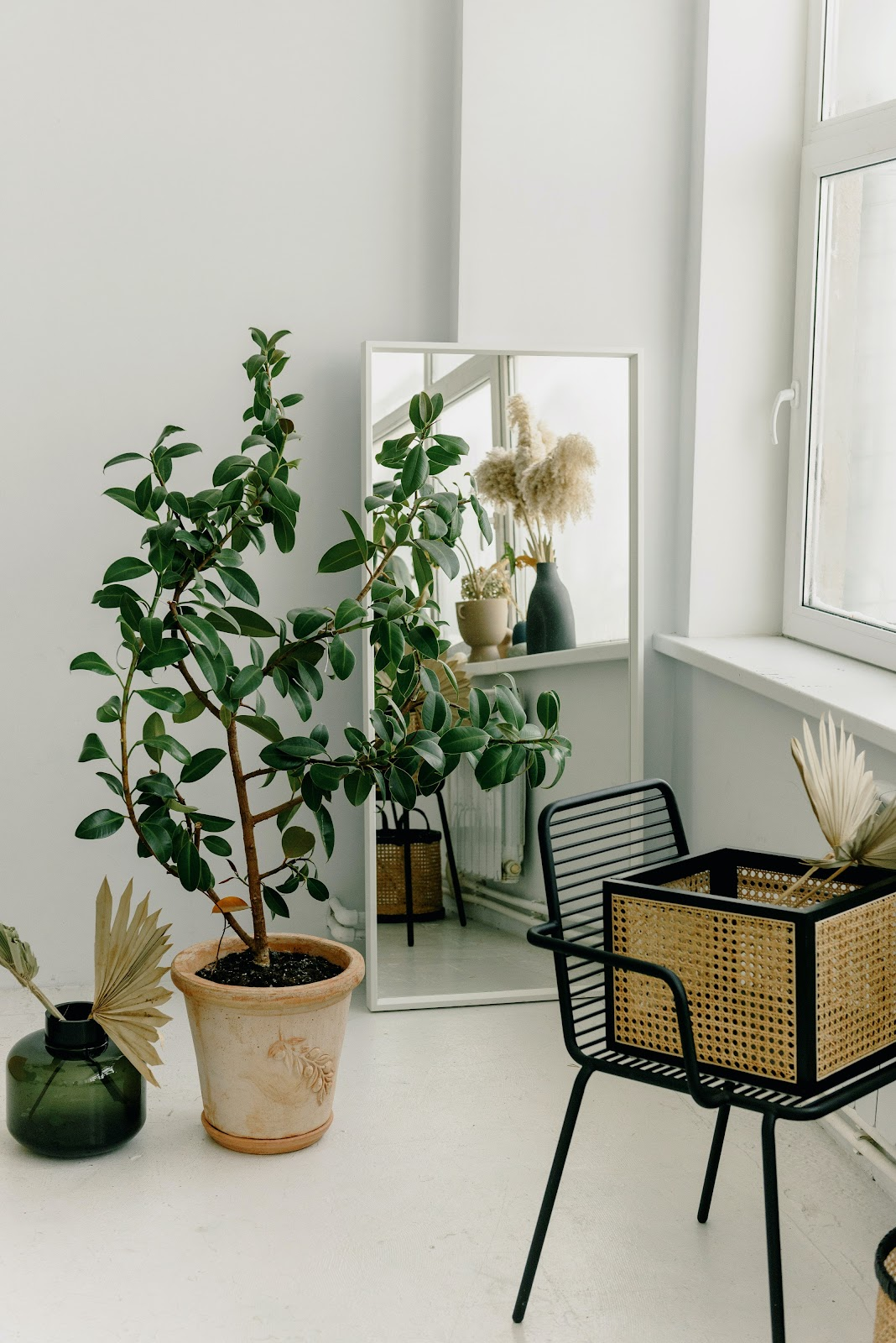 corner of a condo unit space with interior design and indoor plants for minimalist living in a condo for sale unit