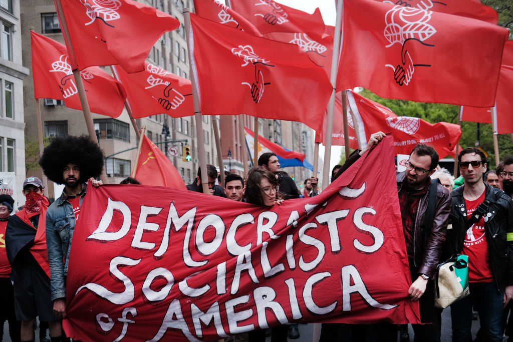 Members of the Democratic Socialists of America gather outside of a Trump owned building on May Day on May 1, 2019 in New York City. DSA members swept the entire Nevada Democratic Party in a recent Central Committee election.