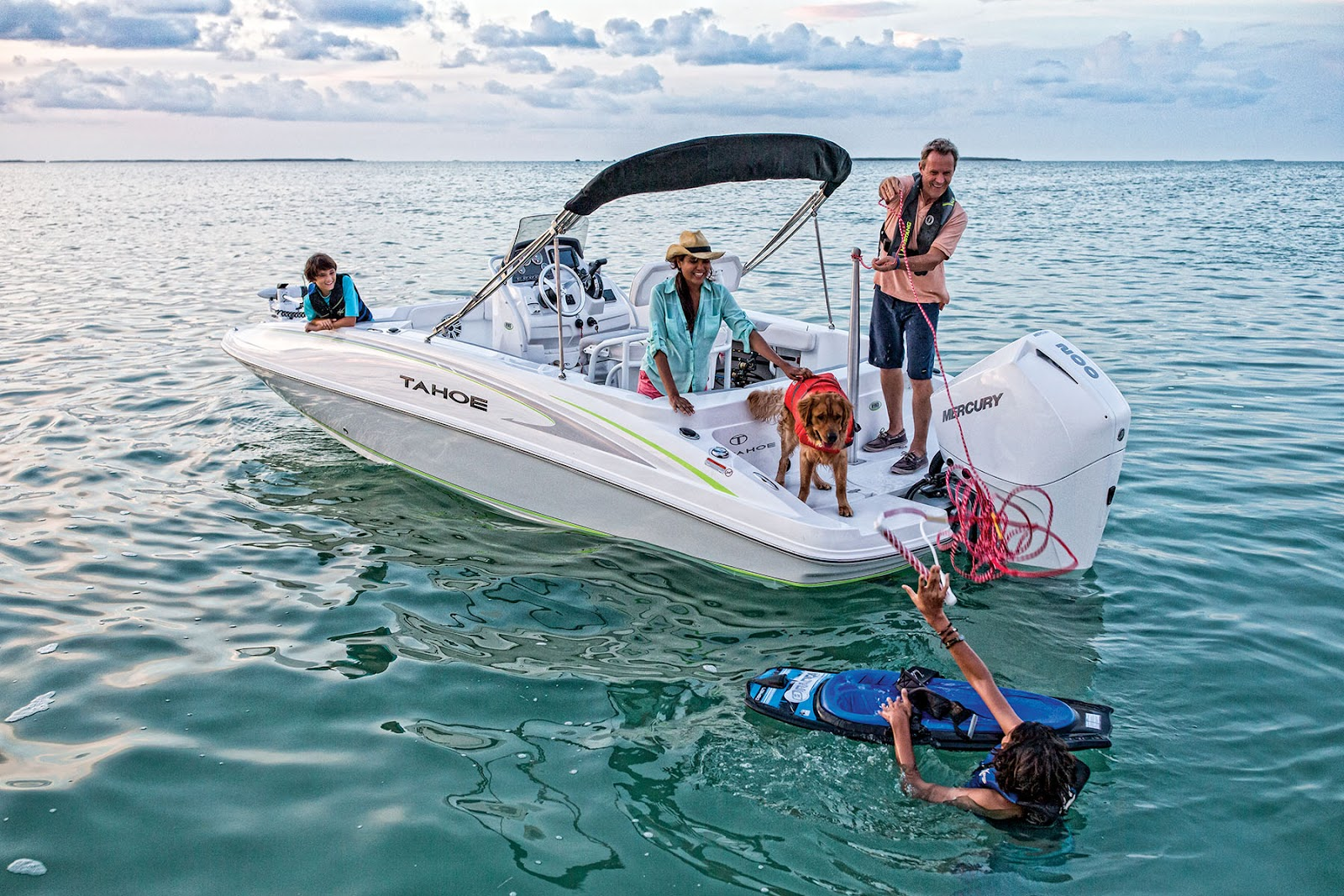 A family prepares to start some towing water sports with a Tahoe 2150 CC runabout boat in this file photo.