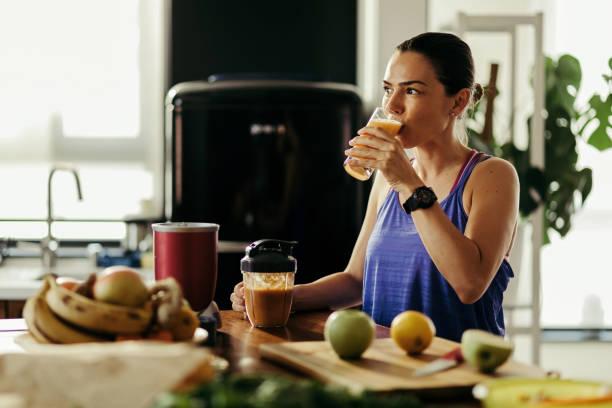 woman drinking healthy juice