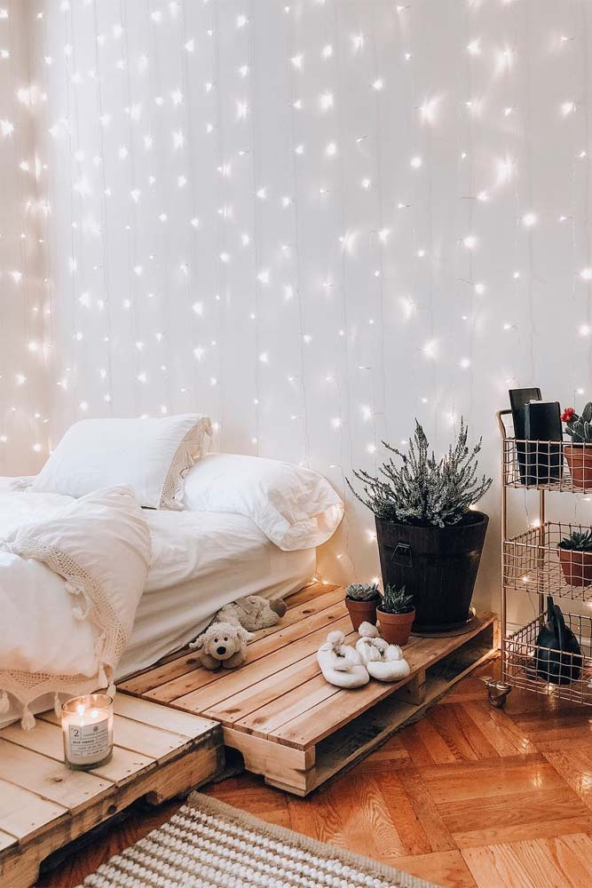 Bedroom setting with twinkle lights on the wall
