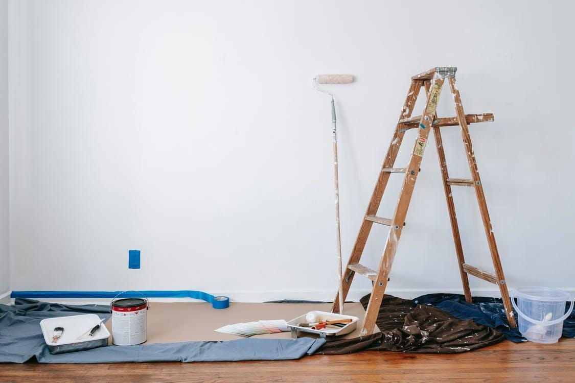 Brown Wooden Ladder Beside Painting Materials