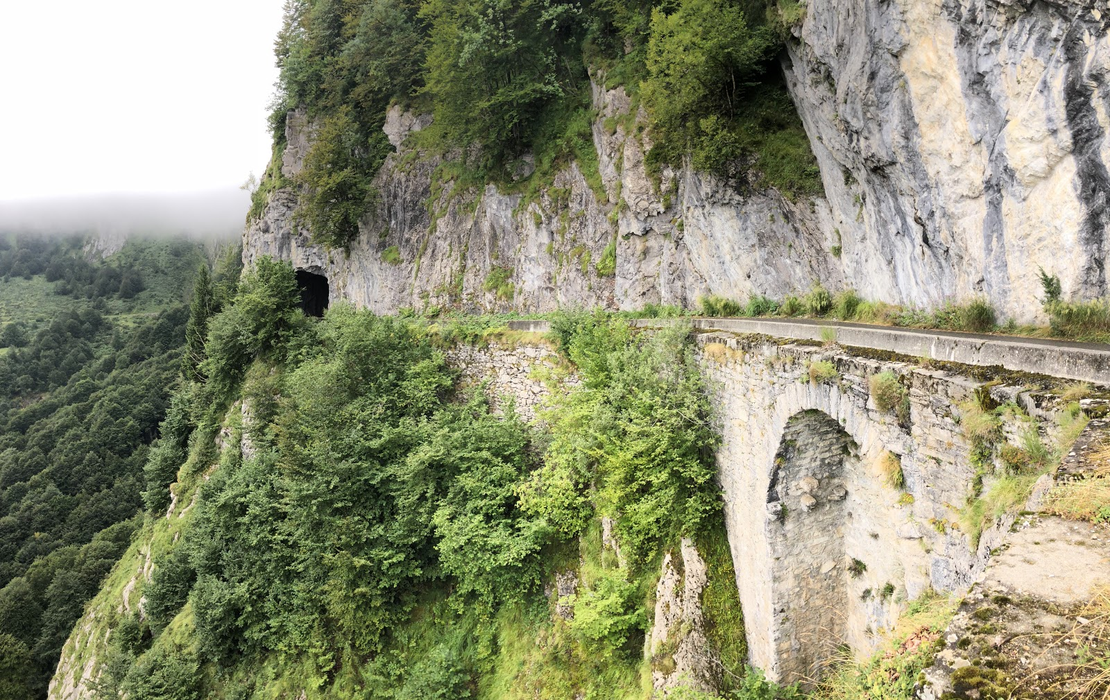Cycling Col d'Aubisque from Ferrières - roadway, tunnel and cliff between Col du Soulor and Col d' Aubisque