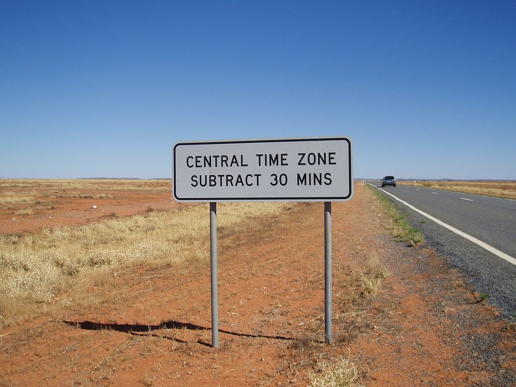 Central time zone sign by side of road, Crossing the time zone on the Broken Hill to Menindee Road