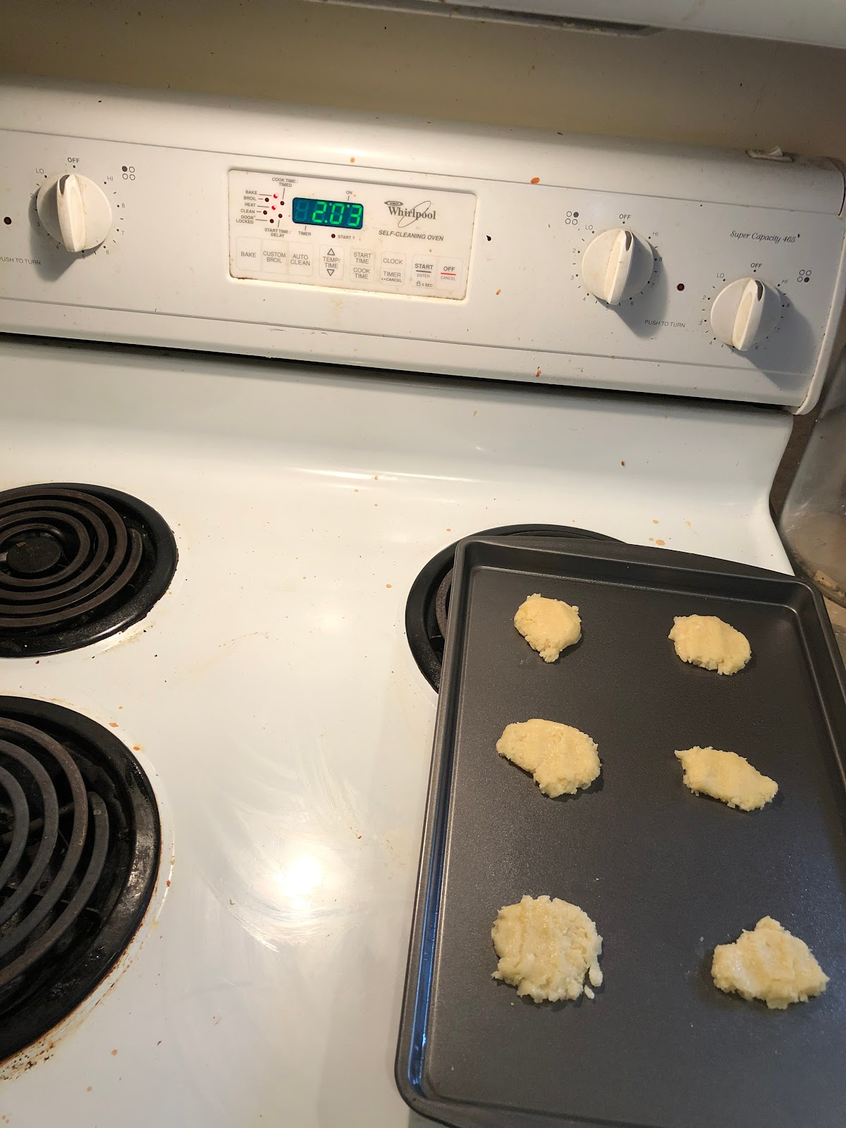 The flattened cookies on a cookie sheet.