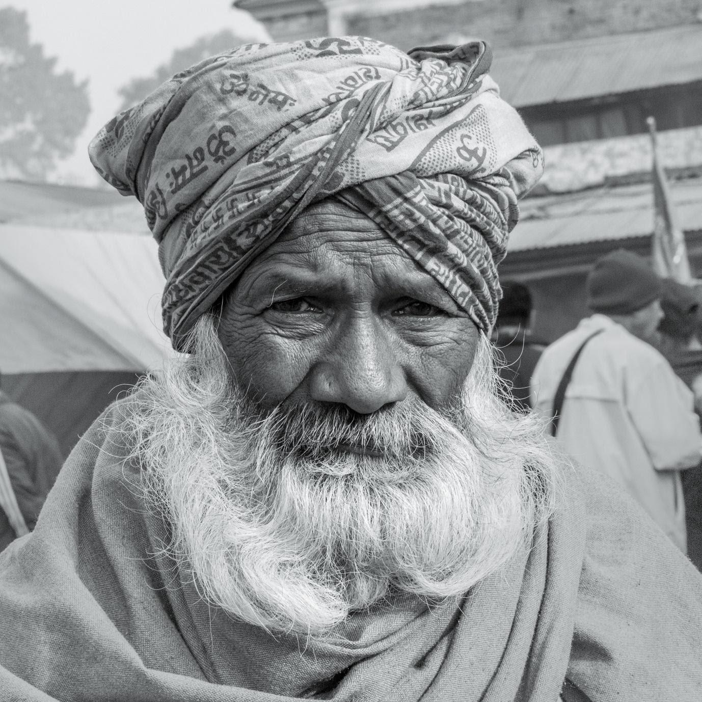 A picture containing person, person, outdoor, turban  Description automatically generated