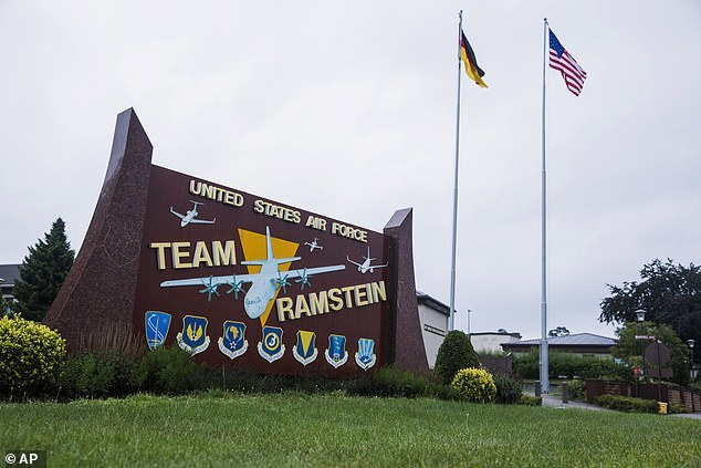 Pictured: US and German flags fly outside the Ramstein Air Base, Germany, where on Saturday a incoming missile alert was triggered causing alarms to be set off