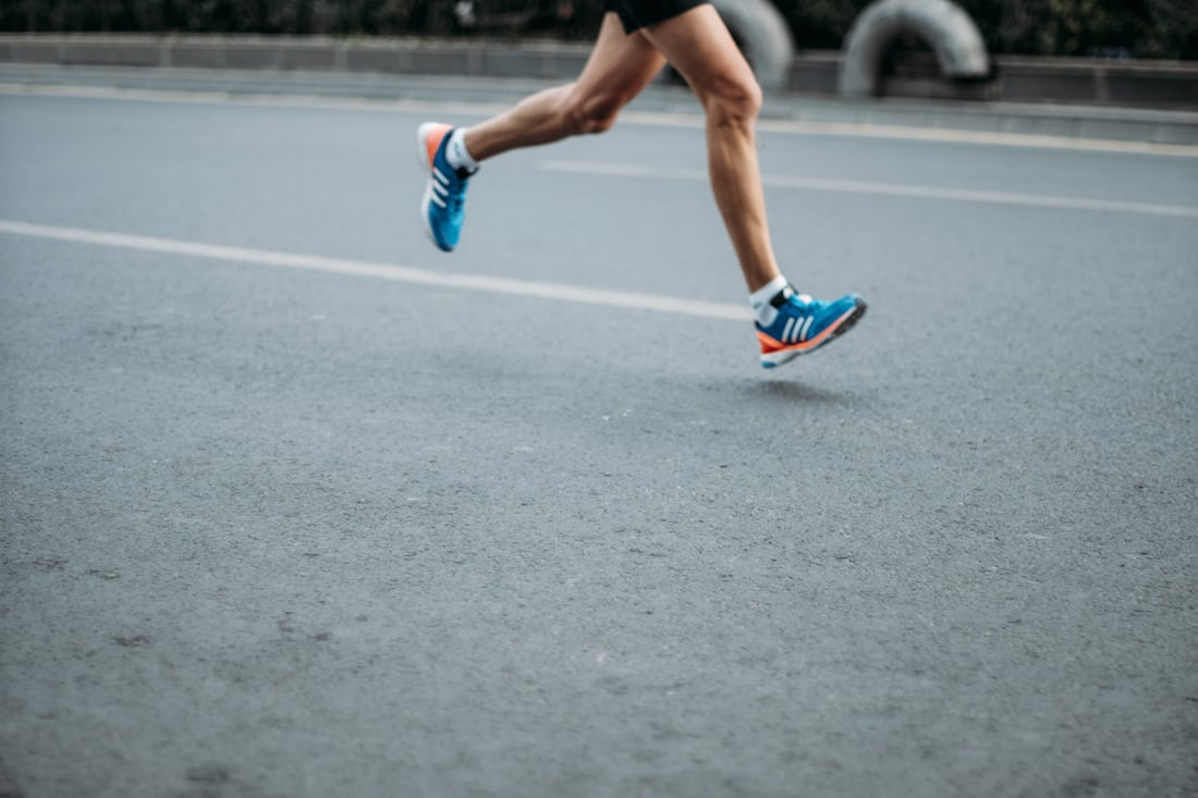 Person running on a road