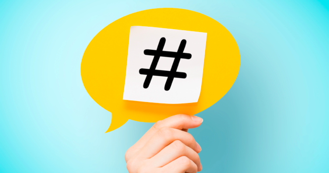 yellow hashtag (hashtags) symbol in a speech bubble being held- SEO Agency Melbourne