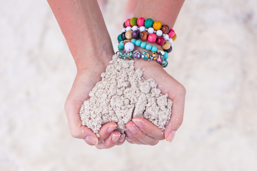 hand holding sand