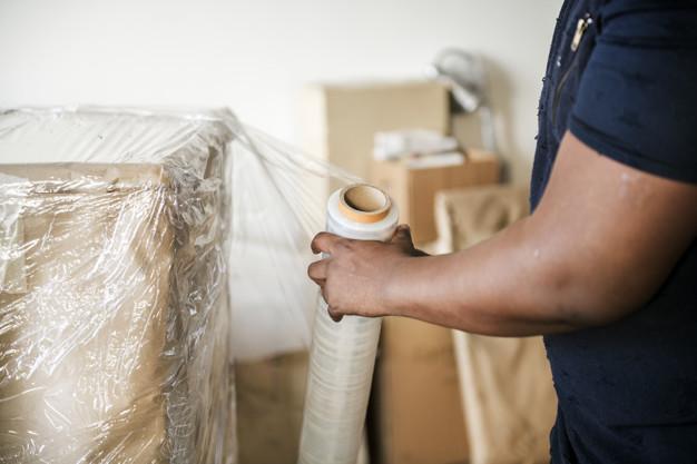 Black man moving furniture Free Photo