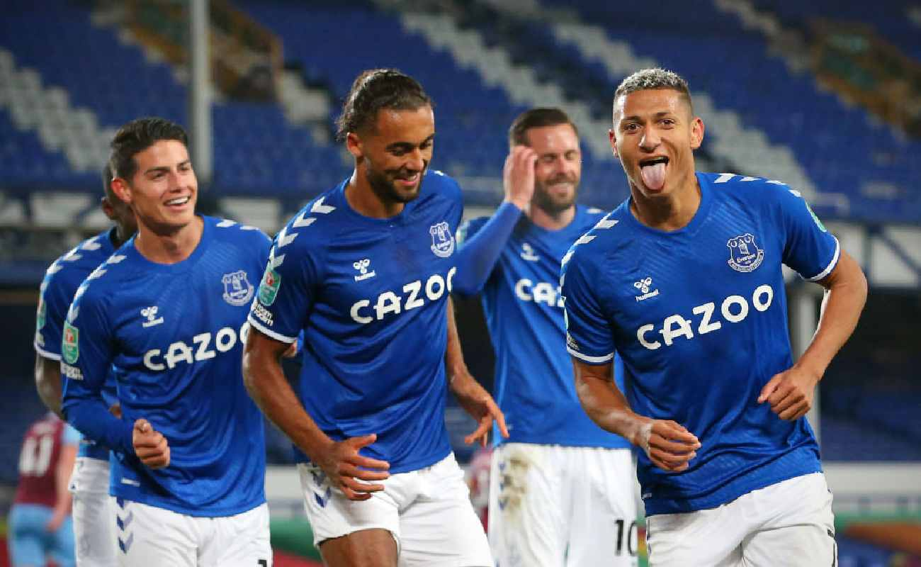 Everton striker Richarlison celebrates with his team after scoring a goal - Photo by ALEX LIVESEY/POOL/AFP via Getty Images