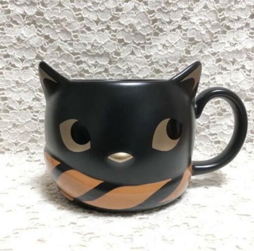 2018 Starbucks cat mug with golden eyes and orange and black striped scarf.