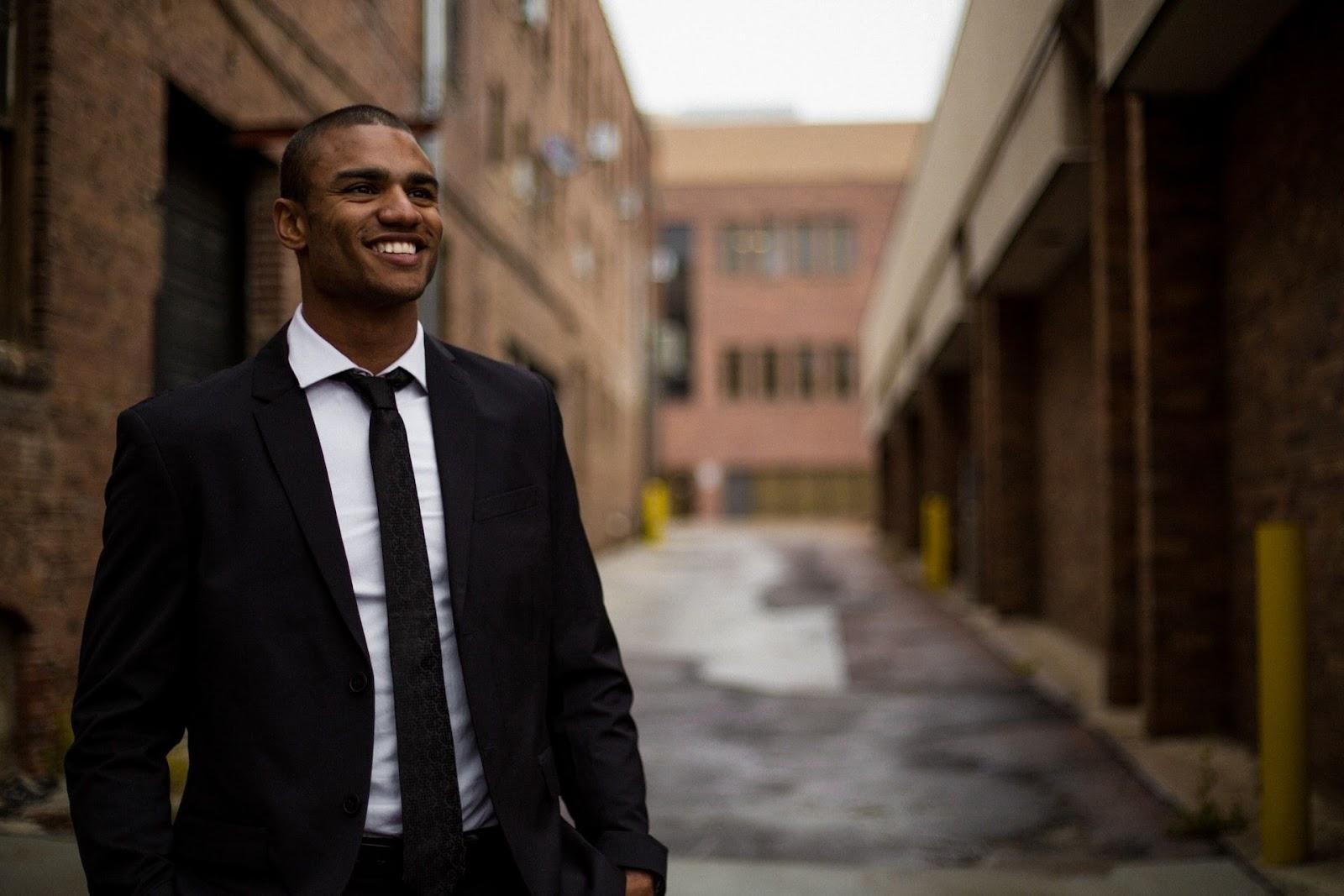 Man in suit smiling pass bar exam