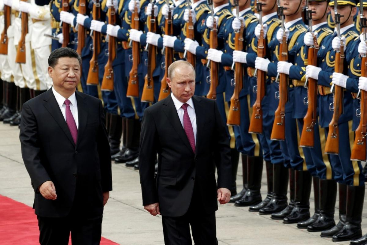 Russian President Vladimir Putin arrives in China for state visit ...