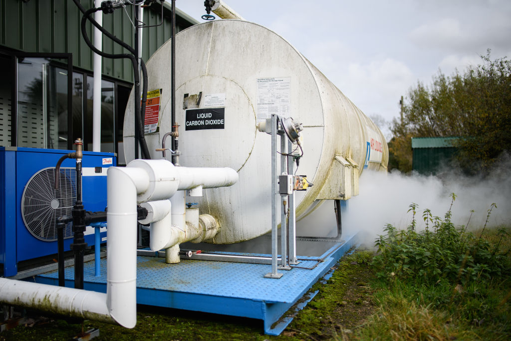 A container of liquid carbon dioxide vents gas during a part of the production process at the Dry Ice Nationwide manufacturing facility on November 11, 2020 in Reading, England.